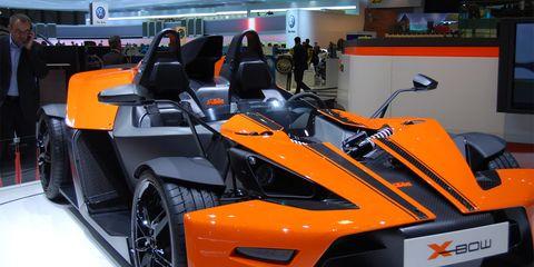 Tire, Automotive design, Mode of transport, Vehicle, Automotive exterior, Transport, Rim, Orange, Car, Fender,