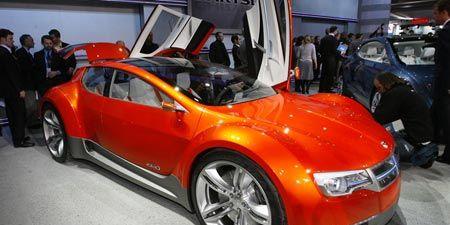 Tire, Wheel, Automotive design, Vehicle, Land vehicle, Car, Concept car, Automotive mirror, Exhibition, Fender,