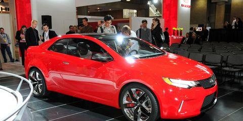 Tire, Wheel, Automotive design, Vehicle, Event, Land vehicle, Car, Red, Exhibition, Auto show,