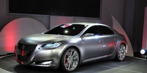 Mode of transport, Automotive design, Vehicle, Event, Car, Personal luxury car, Alloy wheel, Rim, Automotive lighting, Automotive tire,