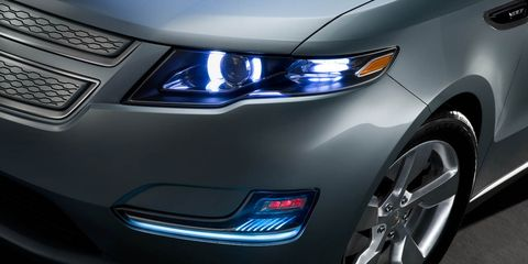 Automotive design, Blue, Daytime, Product, Automotive lighting, Vehicle, Headlamp, Automotive exterior, Car, Grille,