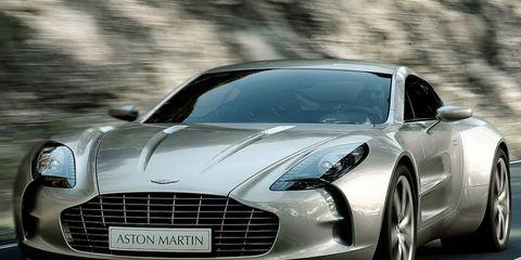 Automotive design, Vehicle, Car, Grille, Sports car, Rim, Performance car, Luxury vehicle, Personal luxury car, Black,