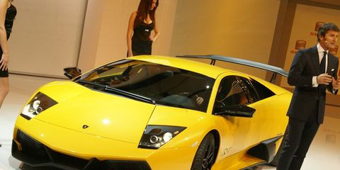 Motor vehicle, Tire, Automotive design, Mode of transport, Vehicle, Yellow, Event, Land vehicle, Transport, Automotive exterior,