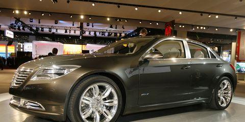 Tire, Wheel, Automotive design, Vehicle, Event, Land vehicle, Alloy wheel, Car, Grille, Personal luxury car,