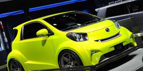 Motor vehicle, Automotive design, Vehicle, Yellow, Land vehicle, Car, Automotive wheel system, Scion iq, Fender, Bumper,