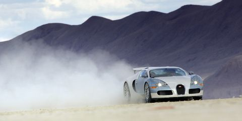 Automotive design, Mountainous landforms, Landscape, Hood, Car, Performance car, Rallying, Atmospheric phenomenon, Headlamp, Hill,