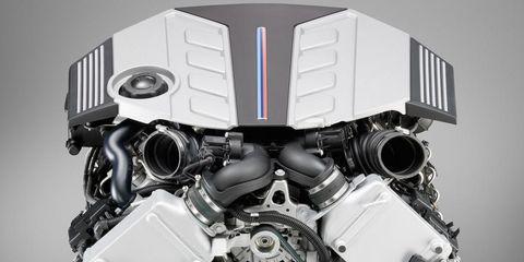 Engine, Motorcycle accessories, Machine, Automotive engine part, Metal, Automotive fuel system, Silver, Automotive super charger part, Nut,