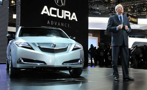 Automotive design, Event, Car, Suit, Grille, Automotive lighting, Logo, Personal luxury car, Mid-size car, Headlamp,