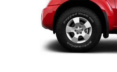 Motor vehicle, Tire, Automotive tire, Automotive tail & brake light, Automotive design, Automotive exterior, Automotive wheel system, Alloy wheel, Rim, Red,