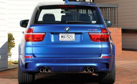 Automotive tail & brake light, Automotive design, Blue, Automotive exterior, Vehicle, Land vehicle, Automotive lighting, Car, Automotive tire, Trunk,