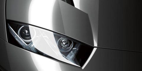Automotive design, Automotive lighting, Headlamp, White, Light, Black, Grey, Automotive light bulb, Monochrome photography, Carbon,