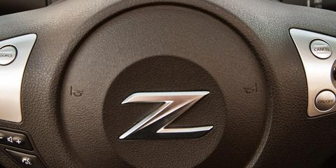 Automotive design, Technology, Logo, Symbol, Machine, Luxury vehicle, Personal luxury car, Brand, Trademark, Multimedia,