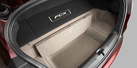 Trunk, Fixture, Luxury vehicle, Family car, Machine, Car seat, Silver, Car seat cover, Carbon, Head restraint,