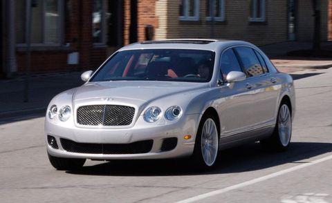 Vehicle, Land vehicle, Car, Automotive parking light, Rim, Grille, Fender, Bentley, Alloy wheel, Automotive tire,