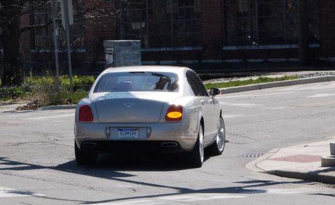 Tire, Mode of transport, Automotive design, Road, Vehicle, Automotive parking light, Vehicle registration plate, Infrastructure, Automotive lighting, Car,