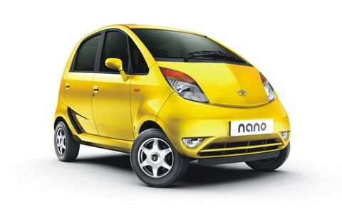 Tire, Motor vehicle, Wheel, Automotive mirror, Mode of transport, Automotive design, Yellow, Transport, Vehicle door, Automotive wheel system,