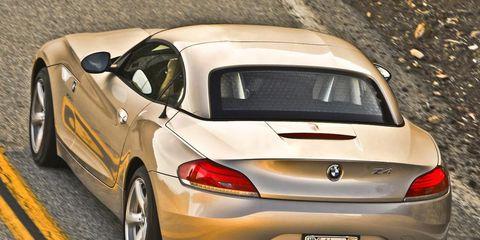 Motor vehicle, Tire, Mode of transport, Automotive design, Yellow, Vehicle, Vehicle door, Red, Automotive exterior, Car,