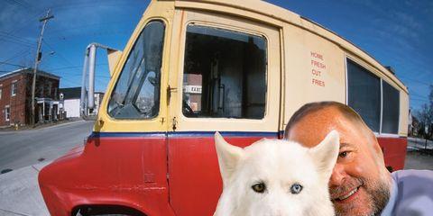 Dog, Carnivore, Fender, Dog breed, Automotive tire, Automotive parking light, Jaw, Rim, Snout, Vehicle door,