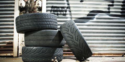 Tire, Automotive tire, Automotive wheel system, Synthetic rubber, Rim, Tread, Auto part, Carbon, Black, Tints and shades,