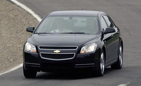 Motor vehicle, Automotive mirror, Vehicle, Automotive design, Glass, Automotive lighting, Headlamp, Road, Transport, Infrastructure,