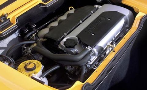 Yellow, Engine, Automotive engine part, Machine, Hood, Automotive air manifold, Automotive super charger part, Kit car, Trunk, Baggage,