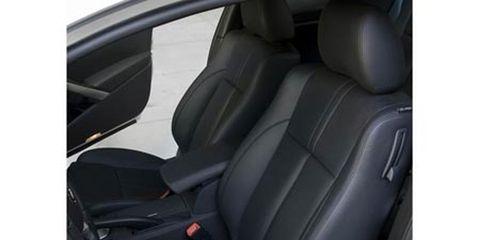 Mode of transport, Car seat, Head restraint, Vehicle door, Car seat cover, Fixture, Seat belt, Luxury vehicle, Leather, Automotive window part,