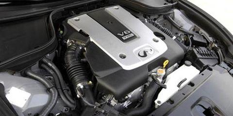 Engine, Automotive engine part, Automotive air manifold, Machine, Fuel line, Automotive super charger part, Nut, Kit car, Automotive fuel system, Screw,