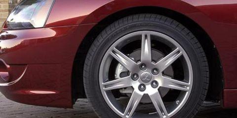 Tire, Wheel, Automotive tire, Automotive design, Alloy wheel, Automotive wheel system, Vehicle, Rim, Automotive exterior, Red,