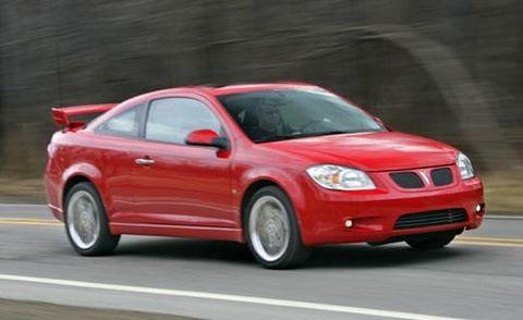 Motor vehicle, Automotive mirror, Road, Mode of transport, Vehicle, Automotive lighting, Infrastructure, Automotive design, Car, Red,