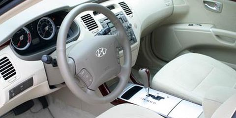 Motor vehicle, Steering part, Mode of transport, Product, Steering wheel, Automotive design, Transport, Photograph, Car, White,