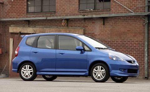 Tire, Wheel, Motor vehicle, Automotive mirror, Mode of transport, Automotive design, Blue, Window, Daytime, Brick,