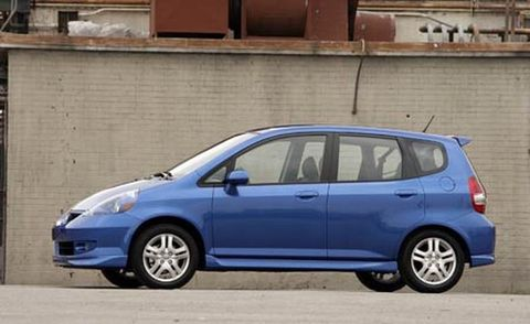 Tire, Wheel, Motor vehicle, Automotive mirror, Mode of transport, Automotive design, Blue, Daytime, Vehicle, Land vehicle,