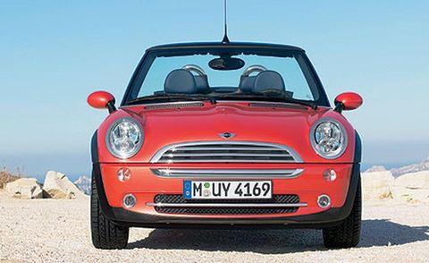 Automotive design, Automotive mirror, Mode of transport, Grille, Windscreen wiper, Hood, Headlamp, Vehicle door, Automotive parking light, Red,
