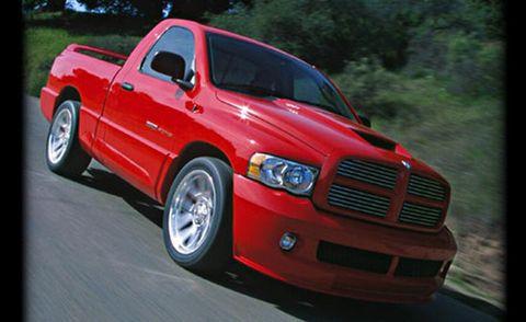 Tire, Wheel, Automotive design, Vehicle, Automotive tire, Land vehicle, Hood, Grille, Truck, Red,
