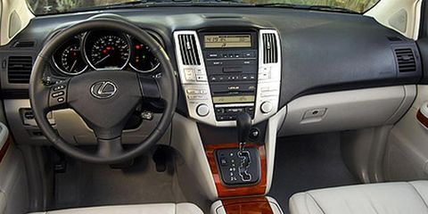Motor vehicle, Mode of transport, Product, Steering part, Automotive design, Transport, Steering wheel, White, Center console, Car,
