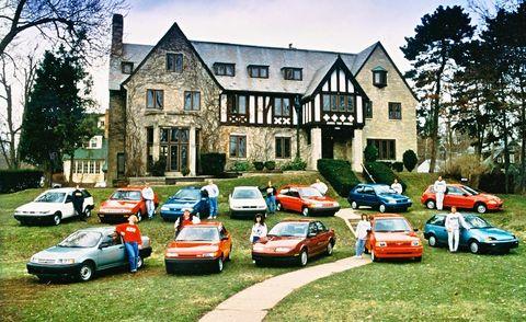 Land vehicle, Mode of transport, Vehicle, Window, Automotive parking light, Car, House, Neighbourhood, Residential area, Building,