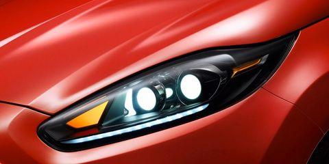 Automotive design, Automotive lighting, Red, Orange, Light, Luxury vehicle, Automotive light bulb, Sports car, Hood, Headlamp,