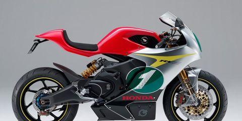 Motorcycle, Tire, Wheel, Motor vehicle, Automotive tire, Automotive design, Transport, Land vehicle, Rim, Spoke,