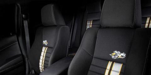 Motor vehicle, Mode of transport, Car seat, Car seat cover, Head restraint, Vehicle door, Leather, Luxury vehicle, Seat belt, Armrest,