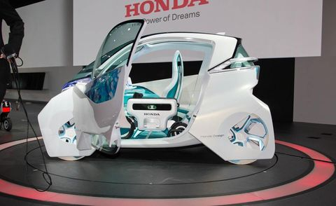 Automotive design, Automotive exterior, Logo, Bumper, Concept car, Machine, Automotive light bulb, Auto part, Auto show, Design,