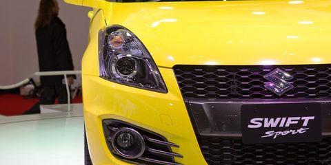 Motor vehicle, Automotive design, Yellow, Vehicle, Automotive lighting, Grille, Automotive tire, Hood, Headlamp, Automotive exterior,