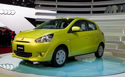Tire, Motor vehicle, Wheel, Automotive design, Mode of transport, Automotive mirror, Vehicle, Yellow, Land vehicle, Automotive lighting,