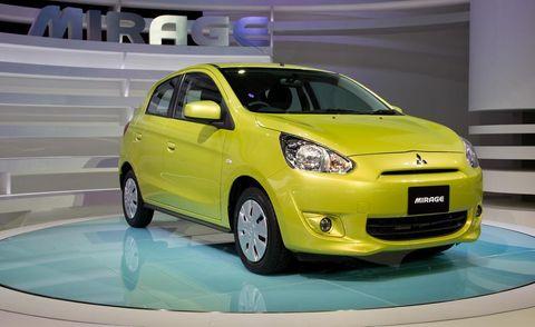 Tire, Motor vehicle, Automotive mirror, Wheel, Automotive design, Vehicle, Yellow, Transport, Vehicle door, Automotive lighting,