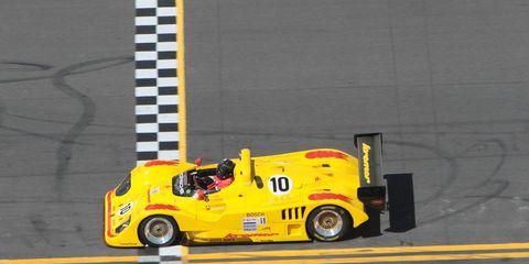 Automotive design, Yellow, Automotive wheel system, Asphalt, Motorsport, Logo, Automotive tire, Race car, Race track, Auto part,
