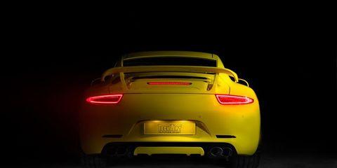 Automotive design, Yellow, Performance car, Car, Automotive lighting, Automotive tail & brake light, Fender, Sports car, Bumper, Vehicle registration plate,