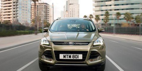 Tire, Motor vehicle, Wheel, Mode of transport, Automotive design, Daytime, Road, Vehicle registration plate, Vehicle, Transport,