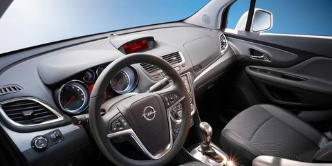 Motor vehicle, Steering part, Mode of transport, Automotive design, Blue, Steering wheel, Product, Transport, Vehicle, Automotive mirror,