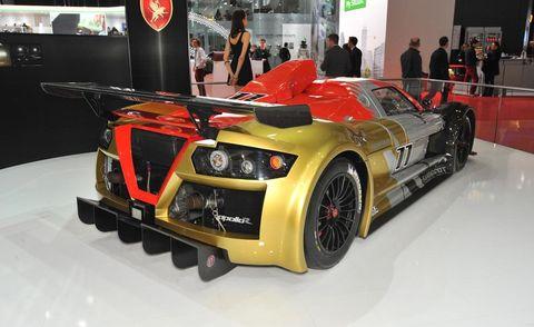 Tire, Automotive design, Vehicle, Performance car, Car, Auto show, Exhibition, Fender, Supercar, Automotive exterior,