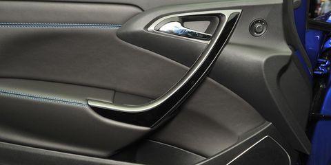 Motor vehicle, Automotive design, Vehicle door, Personal luxury car, Fixture, Luxury vehicle, Carbon, Automotive door part, Gloss, Car seat,