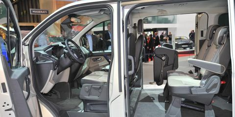 Motor vehicle, Mode of transport, Automotive design, Vehicle, Land vehicle, Vehicle door, Automotive mirror, Automotive exterior, Car seat, Car seat cover,